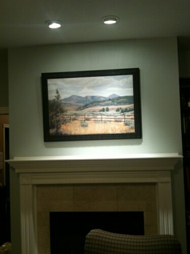 "Painting ""Sleepy Hollow Vista"" framed and hung above the owner's fireplace."